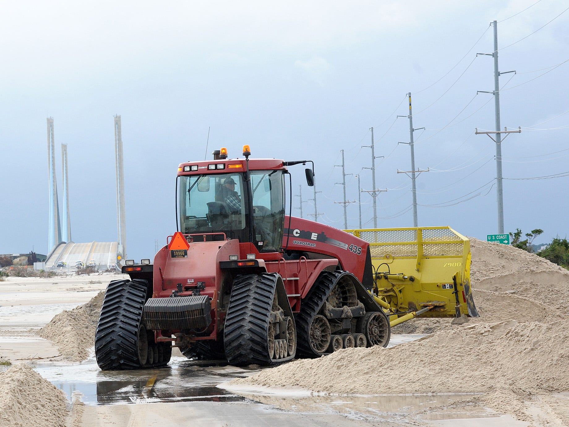 State crews start to work on the damage to the dune line after Hurricane Sandy in Rehoboth Beach, Del., Oct. 30, 2012.