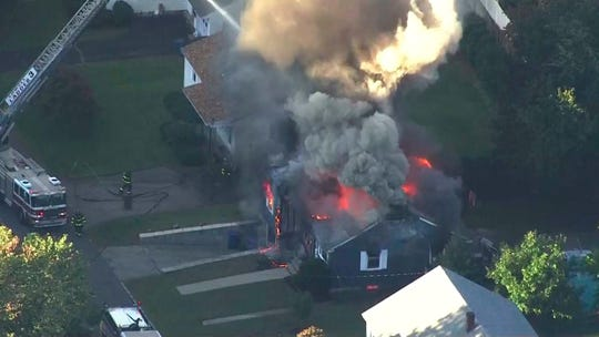 In this image take from video provided by WCVB in Boston, firefighters battle a raging house fire in Lawrence, Mass, a suburb of Boston, Thursday, Sept. 13, 2018. Emergency crews are responding to what they believe is a series of gas explosions that have damaged homes across three communities north of Boston.