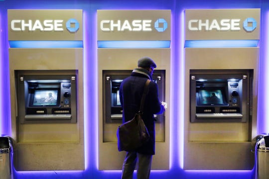 A customer uses an ATM at a branch on Chase Bank, Wednesday, January 14, 2015 in New York.