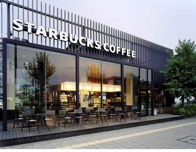 "This Starbucks store in Kyoto, Japan was built to increase energy efficiency uses natural and LED lighting. Starbucks plans to have 10,000 ""Greener"" stores by 2025, including the generation of enough solar and wind power to offset all the electricity need to run all the chain's stores in U.S. and Canada."