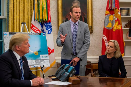 FEMA Administrator Brock Long, center, speaks to members of the media after briefing President Donald Trump on Hurricane Florence in the Oval Office at the White House Sept. 11, 2018, in Washington.