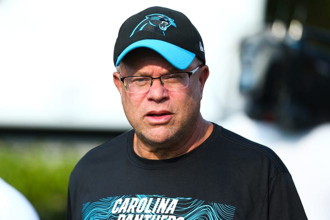 Carolina Panthers new owner David Tepper walks to the field during training camp held at Wofford College.