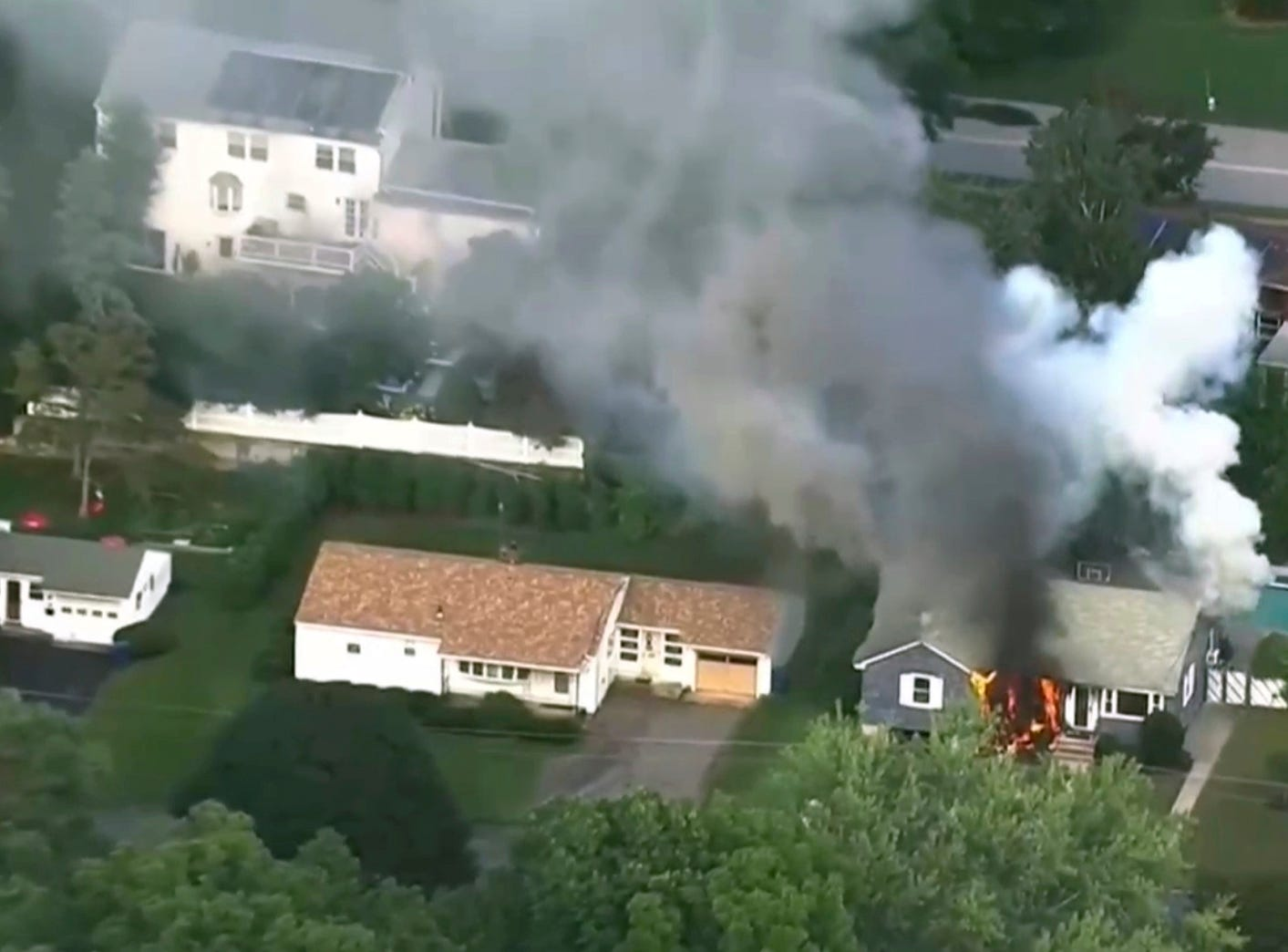 In this image take from video provided by WCVB in Boston, flames rise from a house in Lawrence, Mass, a suburb of Boston, Thursday, Sept. 13, 2018.