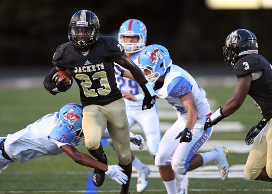 TL Hanna's Isaiah Norris (23) carries against J.L. Mann Thursday, September 13, 2018 at Yellow Jacket Memorial Stadium in Anderson.
