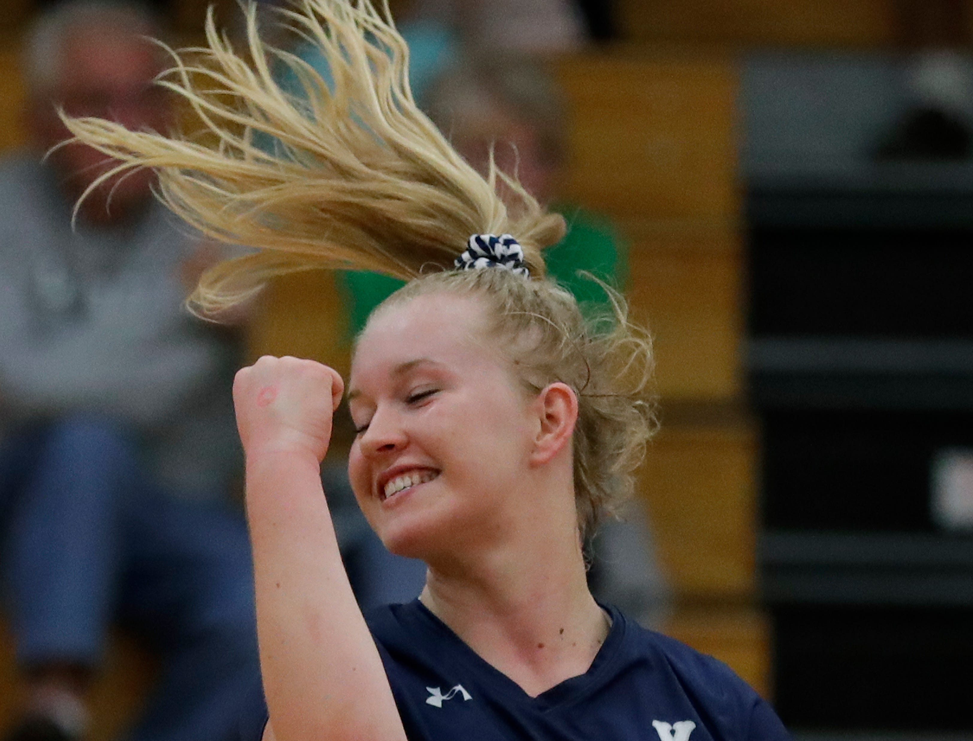 Xavier High School's Emma Oelhafen (10) celebrates winning a point against New London High School during their girls volleyball match Thursday, Sept. 13, 2018, in Appleton, Wis. 