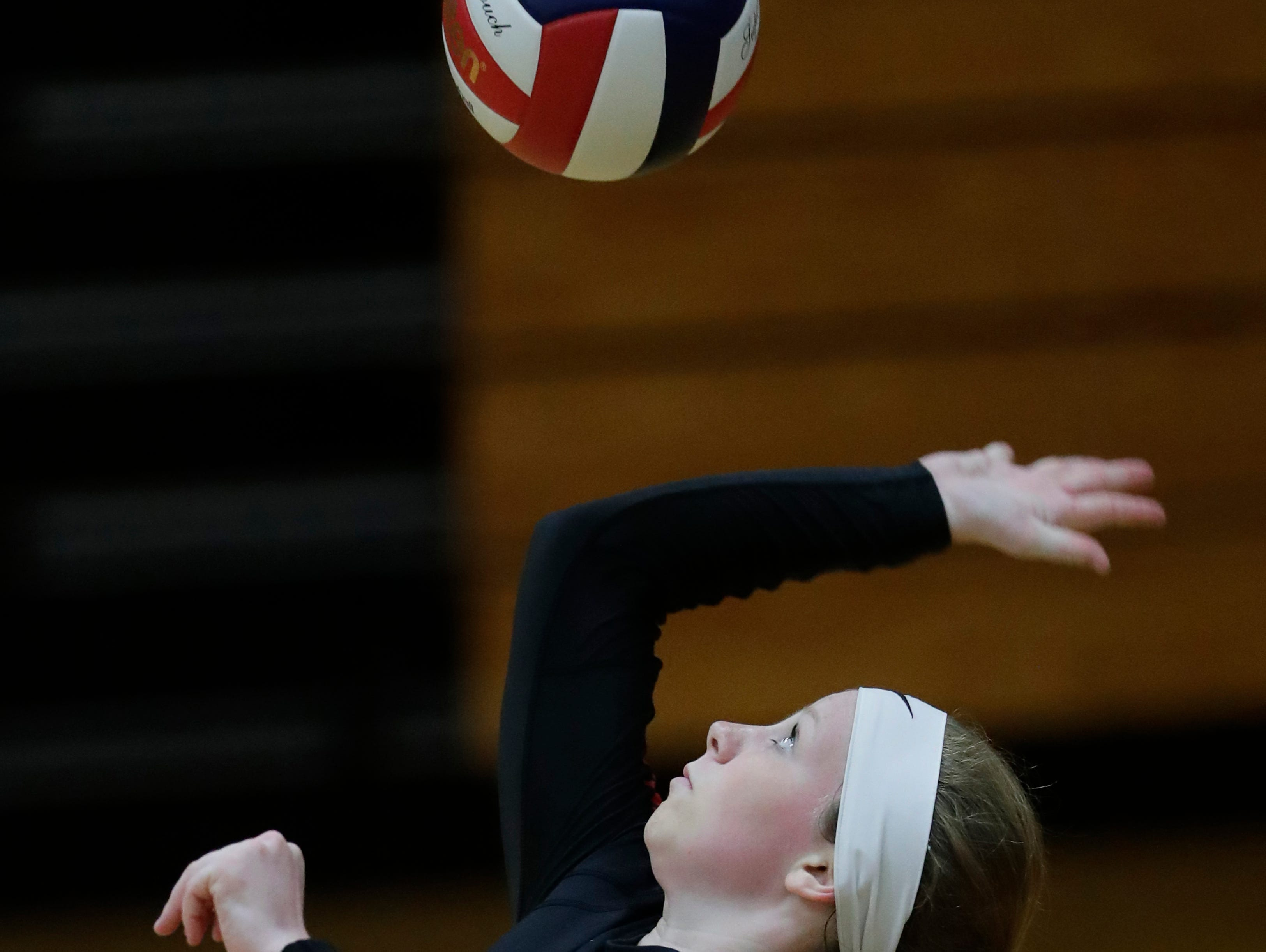 New London High School's Jessica Halvorson (2) serves against Xavier High School during their girls volleyball match Thursday, Sept. 13, 2018, in Appleton, Wis. 