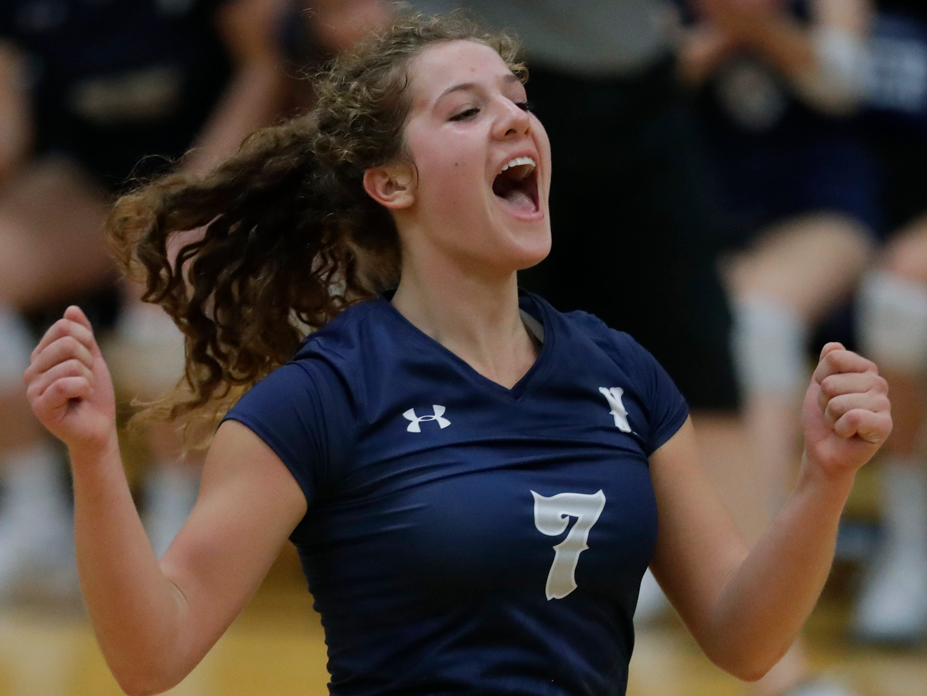 Xavier High School's Anna Hoerning (7) celebrates a point against New London High School during their girls volleyball match Thursday, Sept. 13, 2018, in Appleton, Wis. 