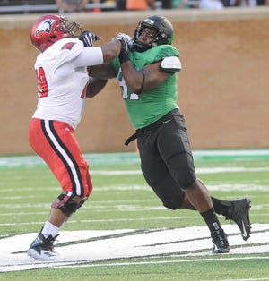 North Texas defensive lineman Dion Novil, right, a Wylie grad, tries to get past an Incarnate Word offensive lineman during their game last Saturday at Apogee Stadium in Denton. North Texas won 58-16.