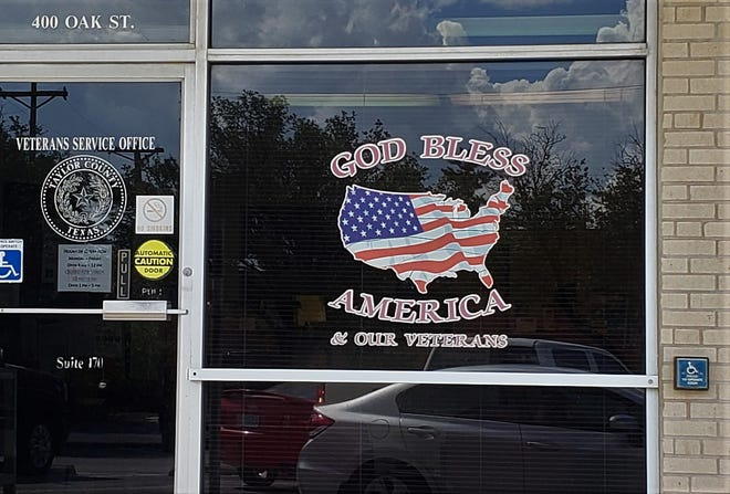 The Freedom From Religion Foundation has written Taylor County about religious symbols, such as this one on the Veterans' Service Office window.