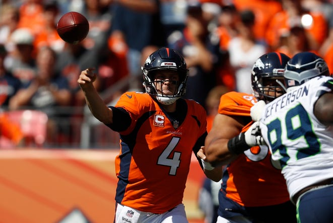 Denver Broncos quarterback Case Keenum throws a pass during the first half against the Seattle Seahawks Sunday, Sept. 9, 2018, in Denver.