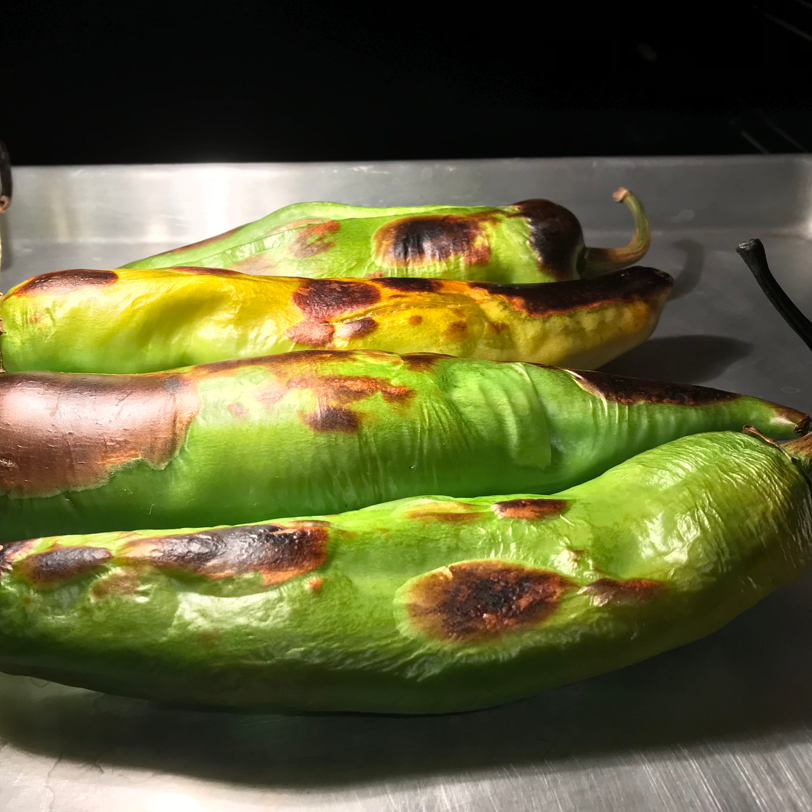 Hatch green chilies roasting in the oven.