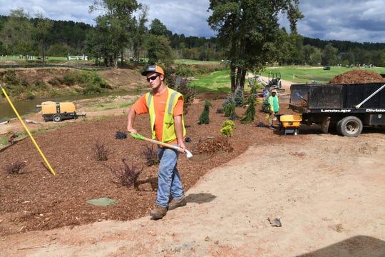 A crew works on the landscaping around the cross country course at the Tryon International Equestrian Center Sept. 14, 2018, the day before the competition.