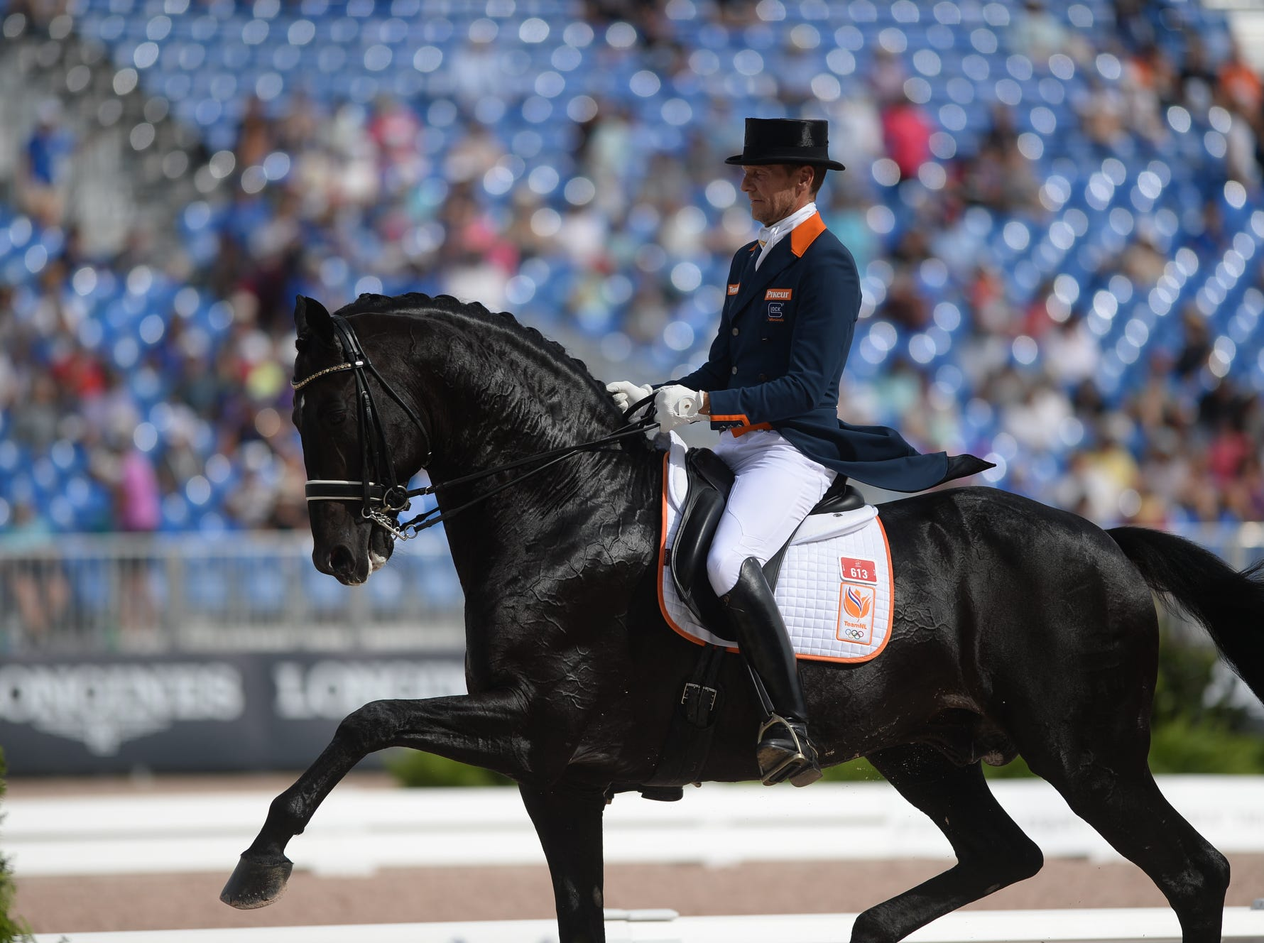 The Netherlands' Edward Gal rides GlockÕs Zonick N.O.P. during the dressage competition at the World Equestrian Games in Tryon Sept. 14, 2018.
