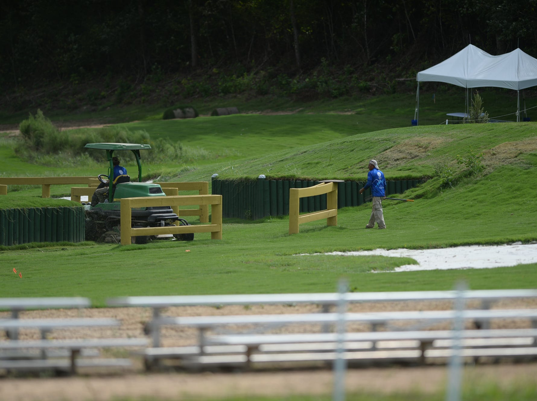 Crews work to ready the cross country course the day before the competition at the World Equestrian Games in Tryon Sept. 14, 2018.