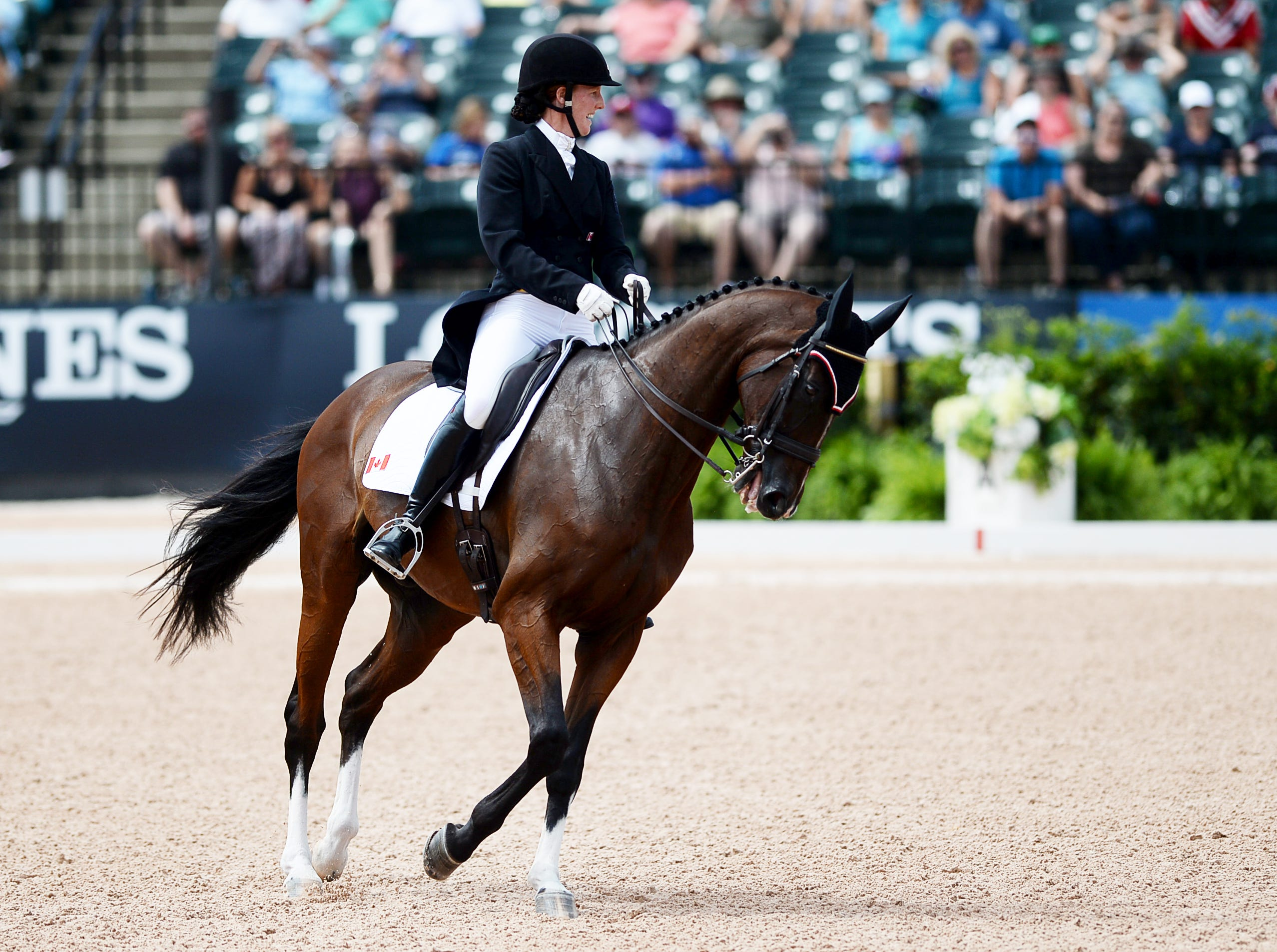 Canada's Selena O'Hanlon rides Foxwood High in the dressage portion of the eventing competition at the World Equestrian Games Sept. 14, 2018.