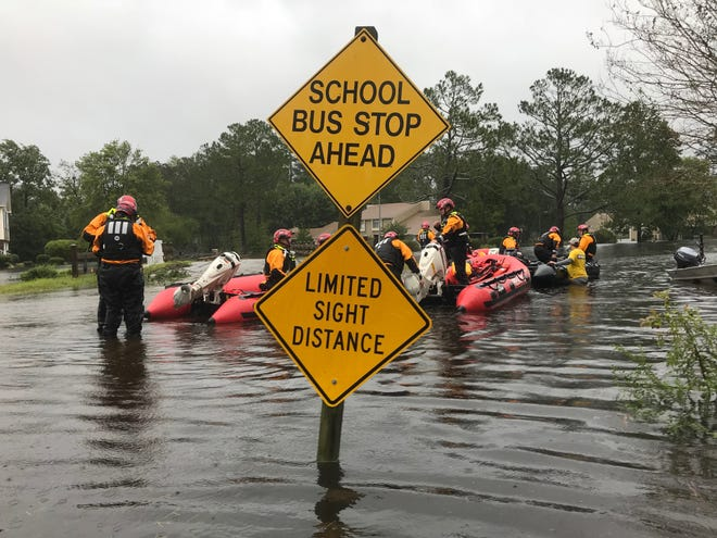 Swift water rescuers travel through the town of River Bend, NC, where emergency personnel have completed swift water rescues as Hurricane Florence's high waters flood streets. River Bend is located southwest of New Bern.