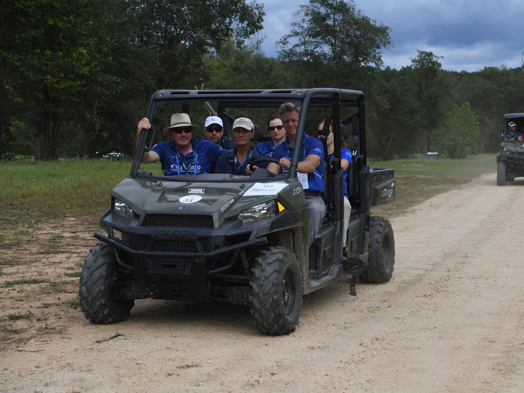 A team from vet services drives around the cross country course Sept. 14, 2018.