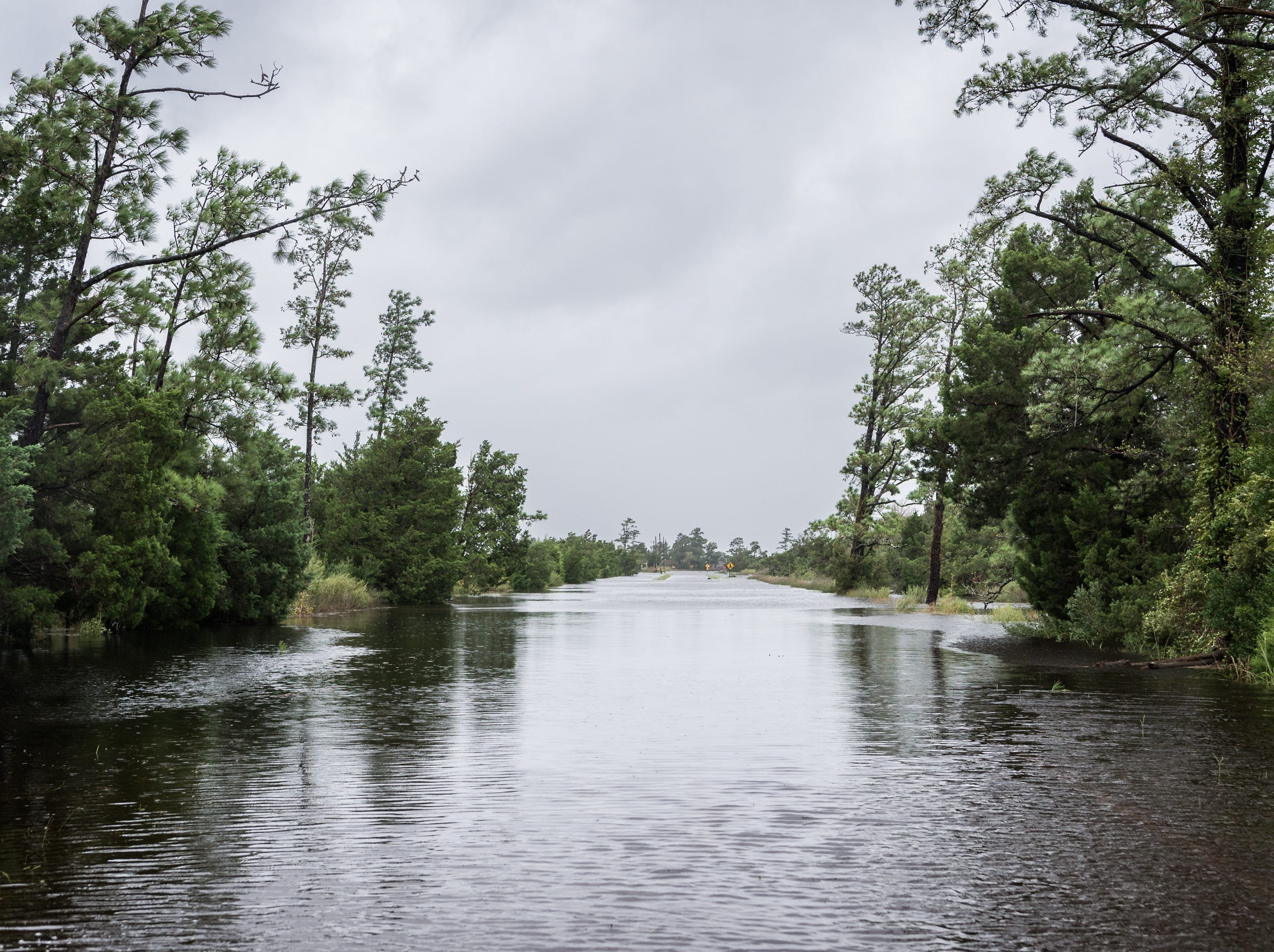 Oyster Creek Street in Swan Quarter N.C sits flooded after Hurricane Florence made landfall in Wilmington, N.C, Sept. 14, 2018.