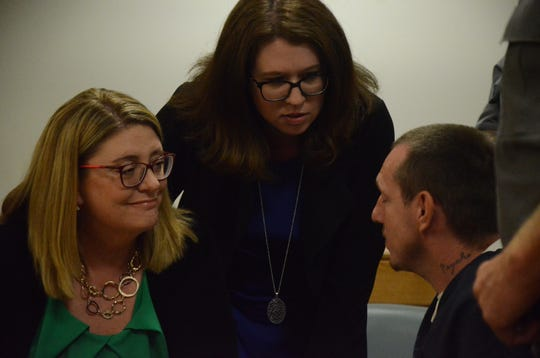Attorneys Tracie Tomak, left, and Kimberly Wickham talk with Thomas Swarmes after a court hearing Friday, Sept. 14, 2018.