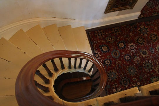 The spiral floating staircase inside the Cronin house.