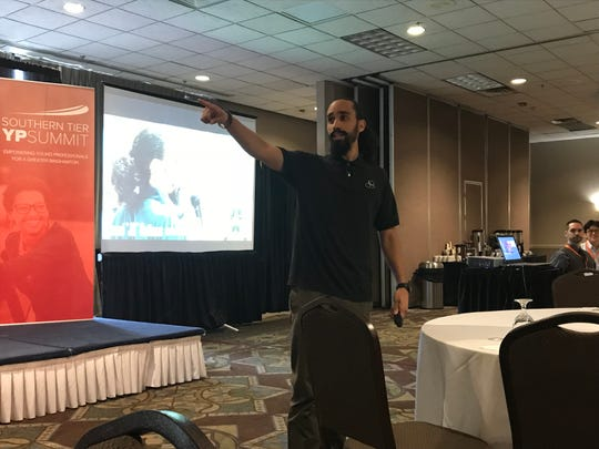 """Josúe """"JQ"""" Quinñones gives his opening speech, """"Your Brand is a Lifestyle"""" at Friday mornings Young Professionals Summit at the Holiday Inn Binghamton Downtown."""