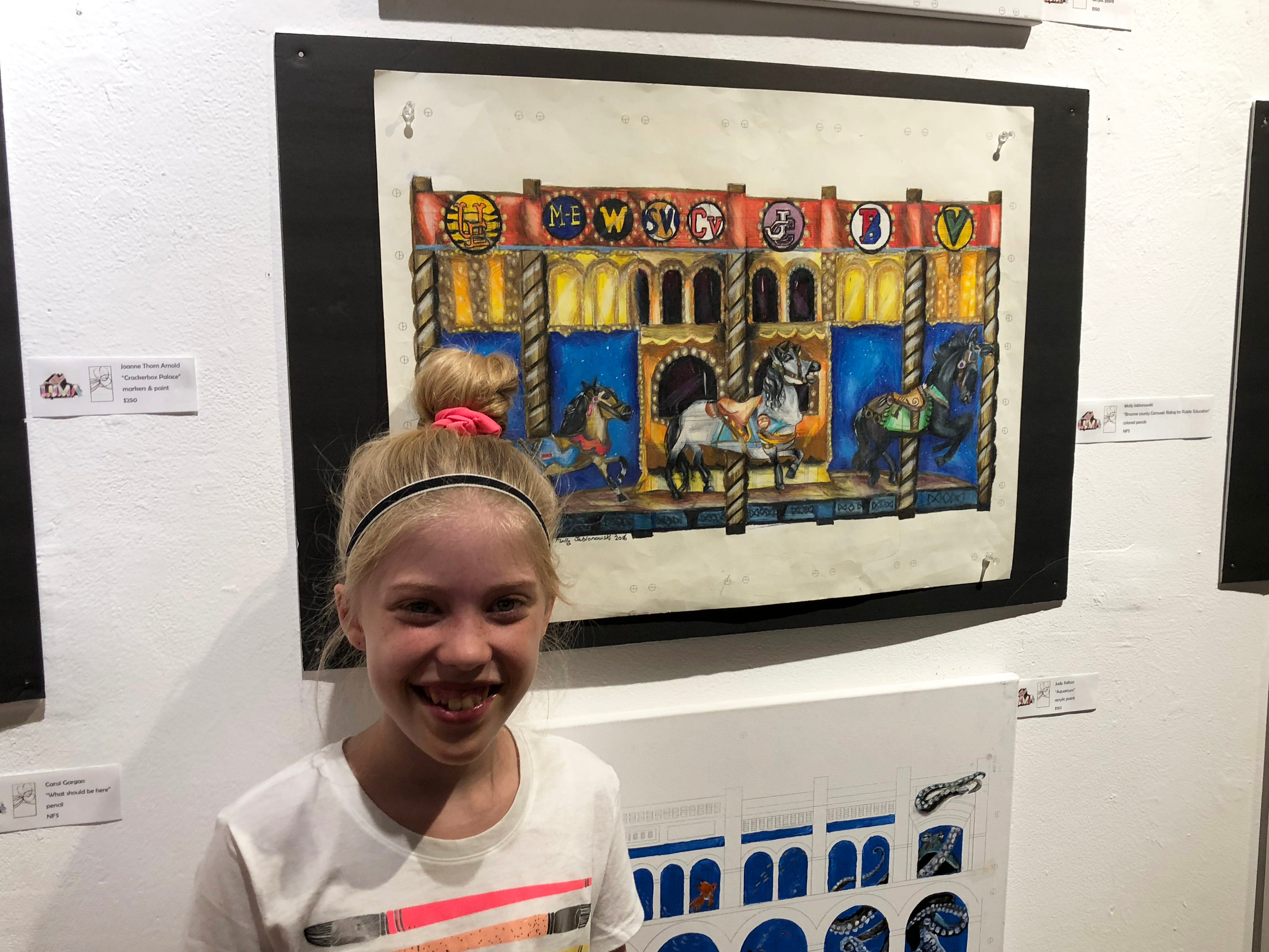 Johnson City Central School District seventh grader Molly Jablonowski, 12, was one of several local artists chosen to have their work blown up on the side of Atomic Tom's for the LUMA Projection Arts Festival Sept. 7-8.