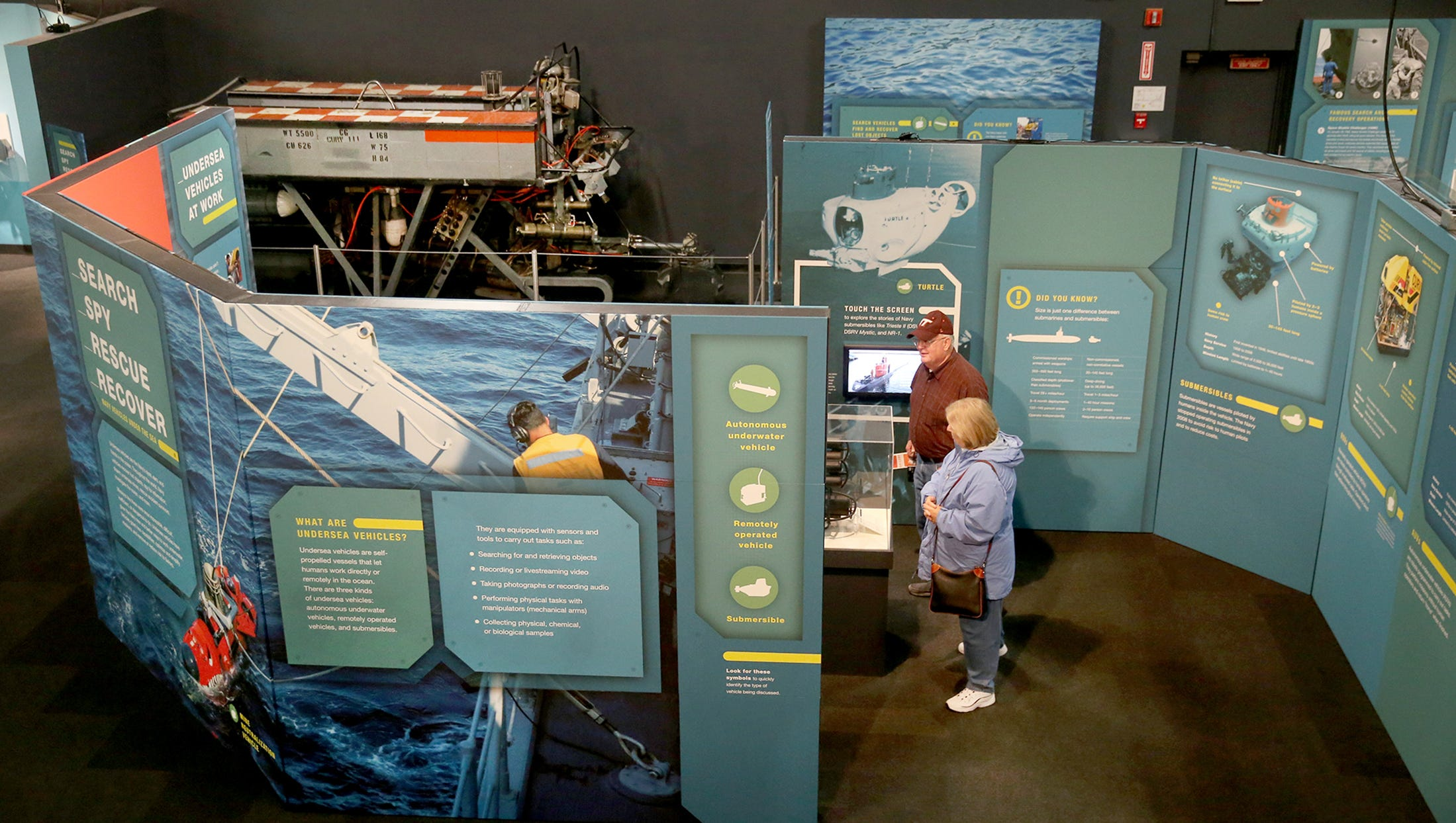 James and Dot Gwaltney of Portsmouth, VA look over the new exhibit  to highlight the growing use of unmanned undersea vehicles for missions that once had been too dangerous for the Navy to carry out At the Keyport Naval Undersea Museum. Undersea vehicles can search for and recover lost objects, collect data, disarm undersea mines and rescue accident survivors - all in places where manned crafts can't safely operate. James worked on submarines at the Newport News, Virginia shipyard.