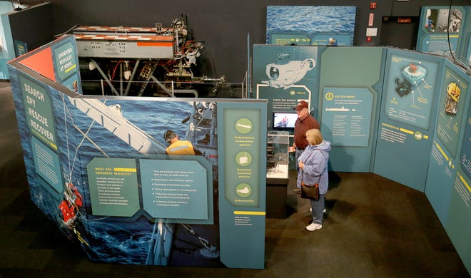 James and Dot Gwaltney of Portsmouth, Virginia, look over the new exhibit highlighting unmanned undersea vehicles at the Keyport's Naval Undersea Museum. Undersea vehicles can search for and recover lost objects, collect data, disarm undersea mines and rescue accident survivors - all in places where manned crafts can't safely operate.