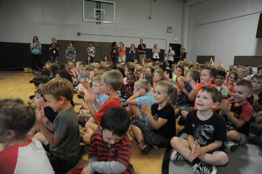 Students at Black Mountain Primary clap following a song by Summer Brooke and the Mountain Faith Band on Sept. 14.