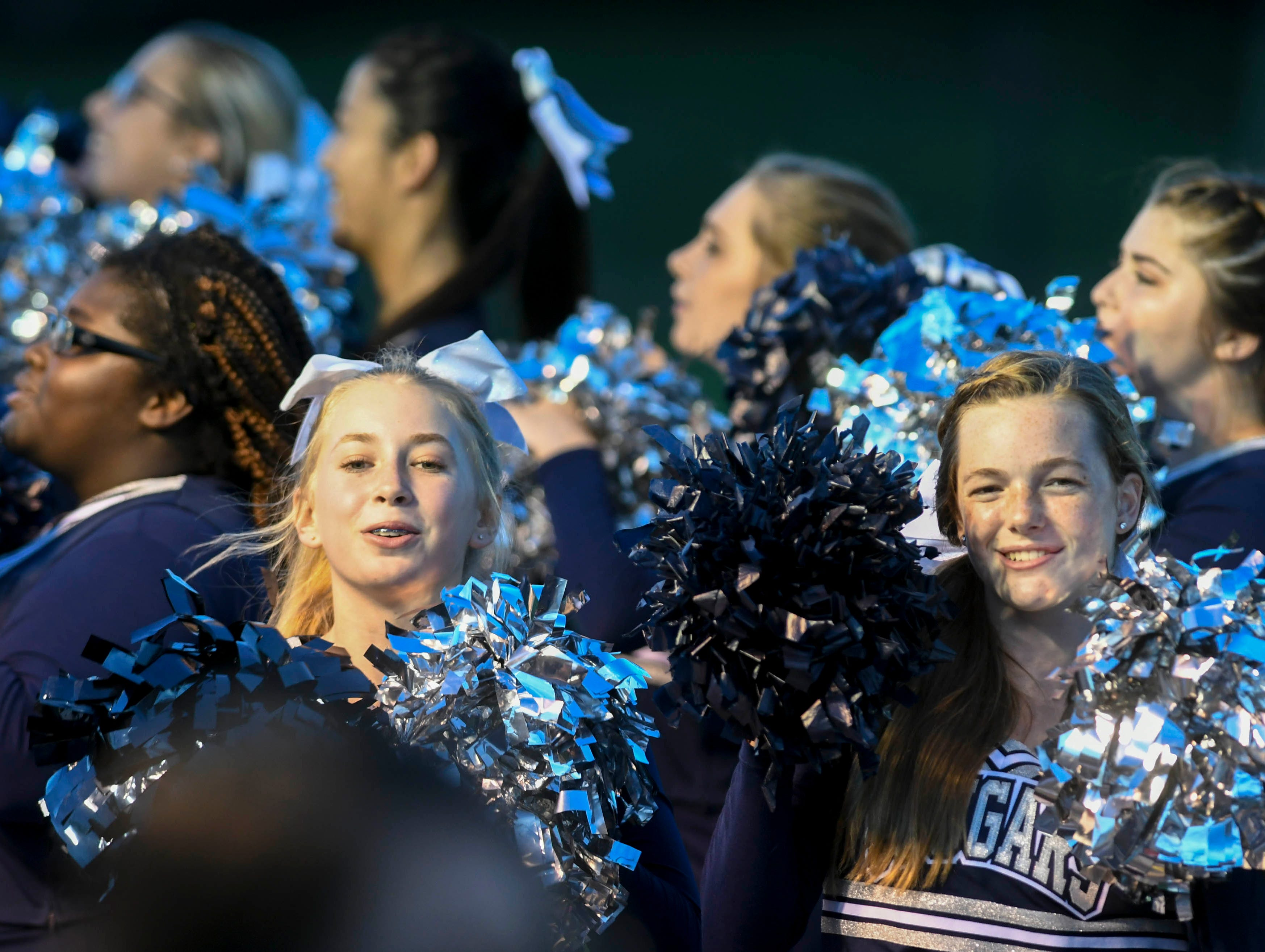 Merritt Island Christian cheerleaders pump up the crowd during Thursday's game.