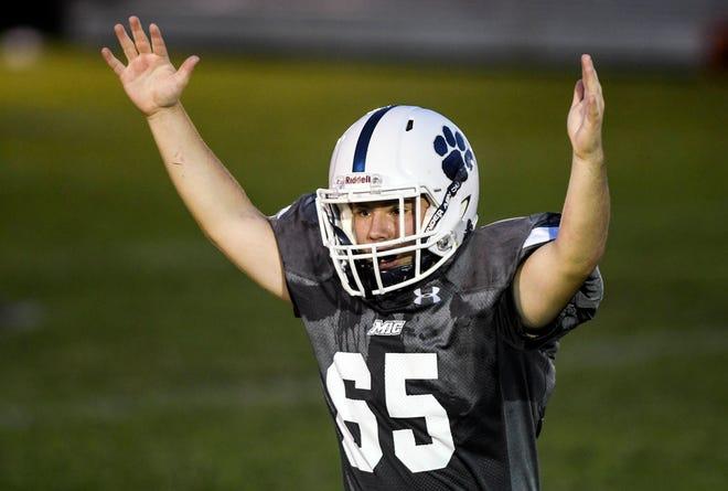 Logan Meade of Merritt Island Christian celebrates a defensive stop during Thursday's game.