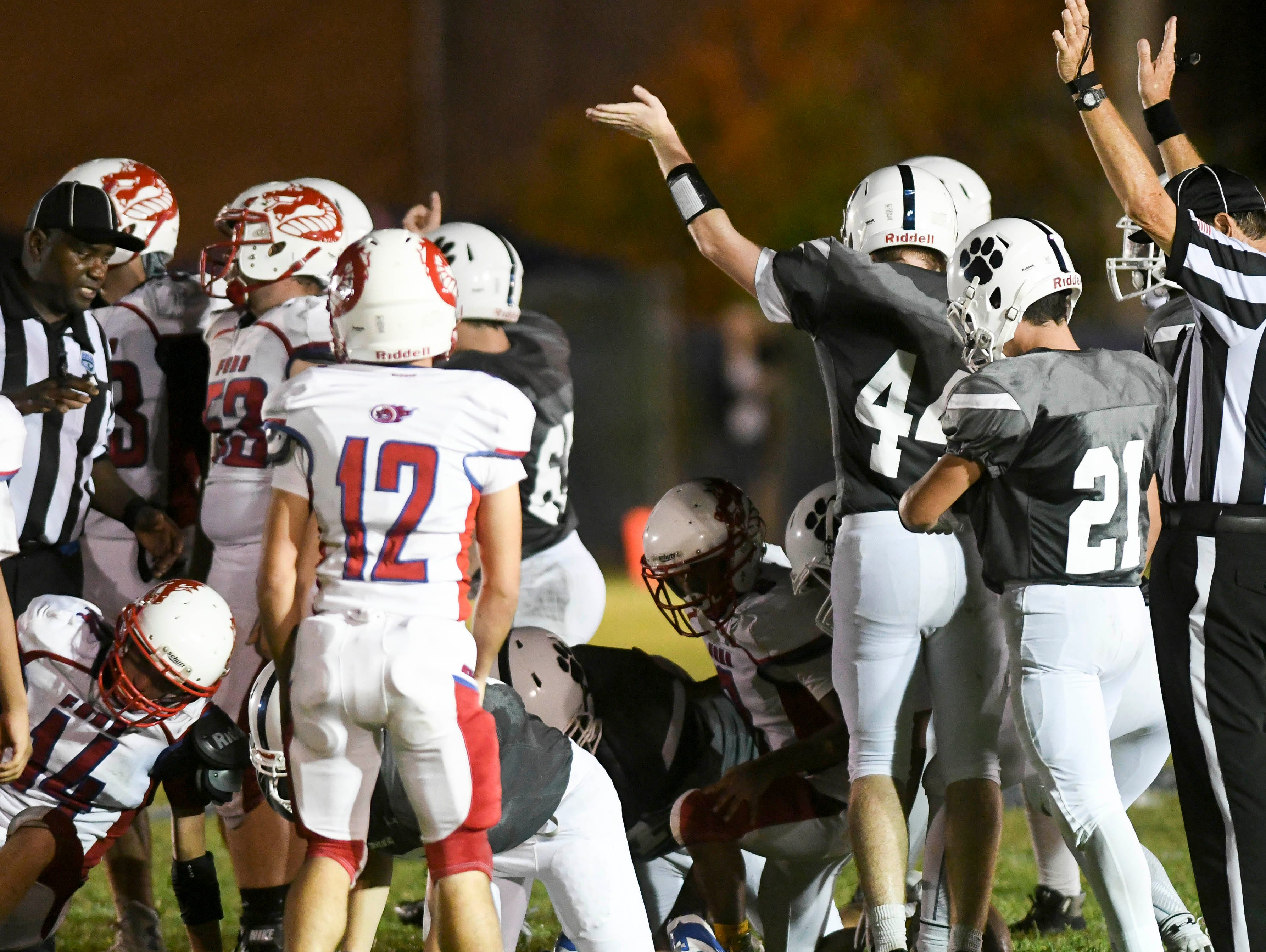 Merritt Island Christian players signal they've recovered a Florida School for the Deaf fumble during Thursday's game.