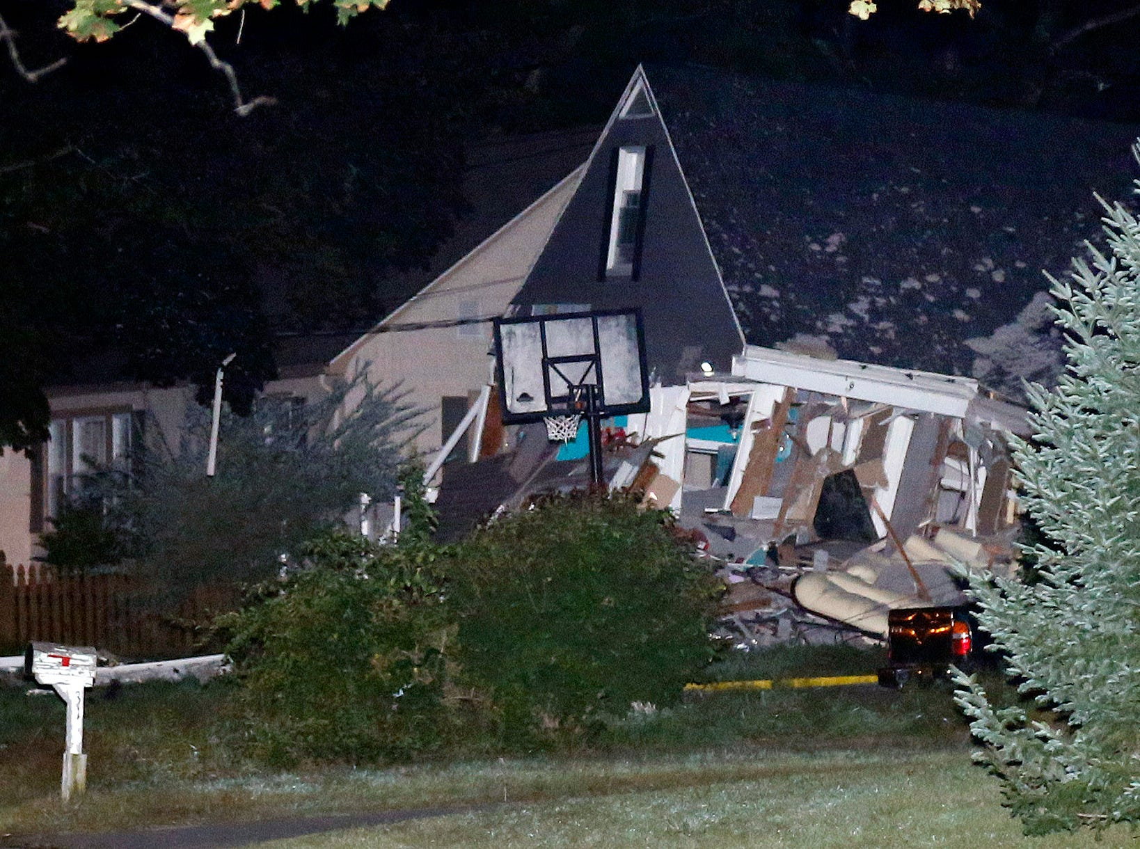 A house is destroyed in Thursday, Sept. 13, 2018, in Lawrence, Mass. A problem with a gas line that feeds homes in several communities north of Boston triggered a series of gas explosions and fires.