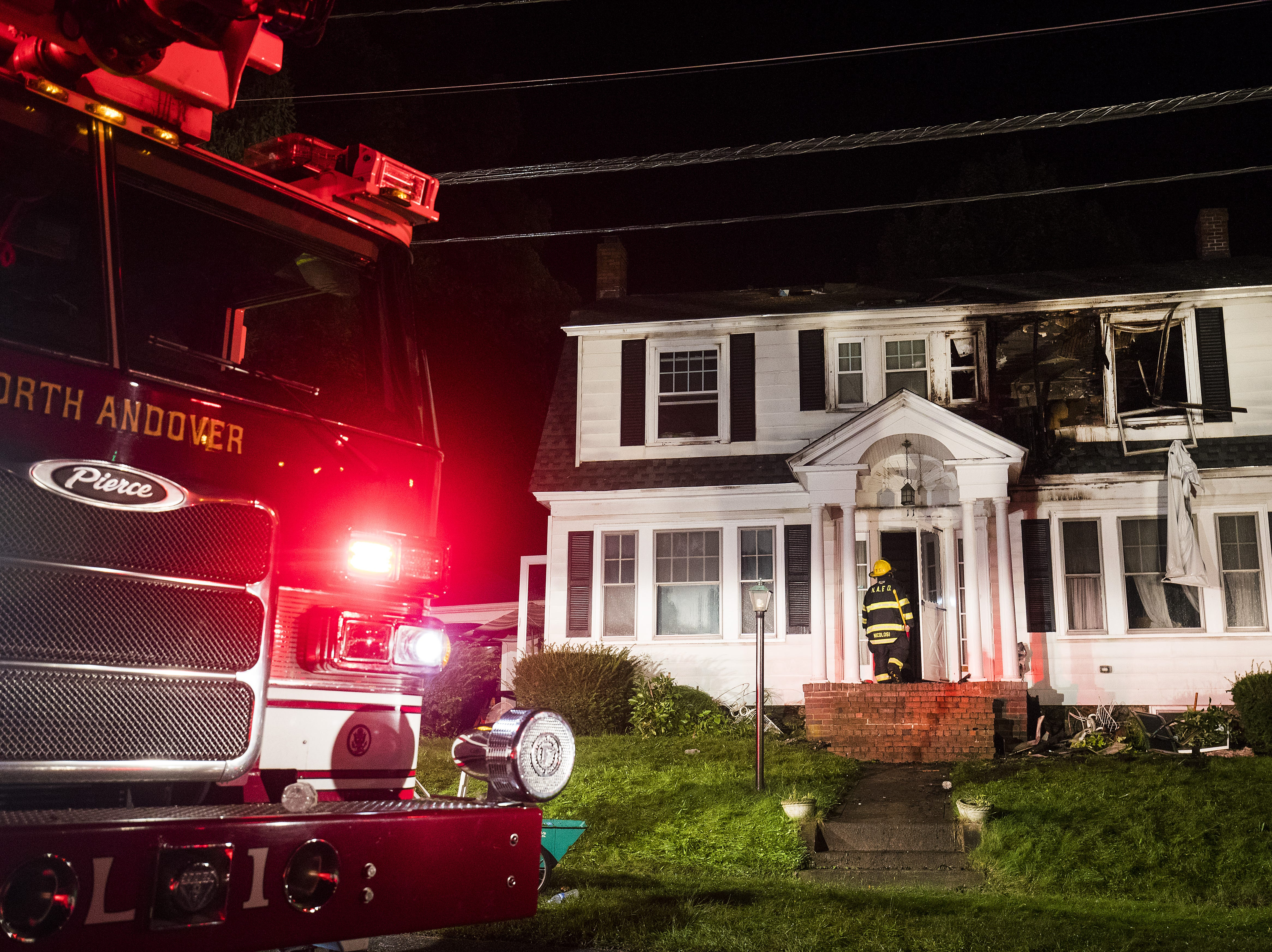 NORTH ANDOVER, MA - SEPTEMBER 13:  Firefighters inspect a home after gas explosions on September 13, 2018 in North Andover, Massachusetts. Gas explosions in three communities north of Boston have left multiple homes on fire.