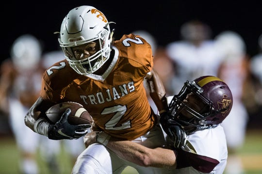 Beeville's Jalen Spicer attempts to escape Tuloso-Midway defenders during their game on Thursday, Sep. 14, 2018, at Veterans Memorial Stadium in Beeville.