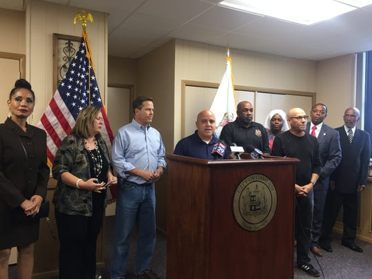 Camden Mayor Frank Moran, flanked by U.S. Rep. Donald Norcross (left) and Camden County Freeholder Jonathan Young, addresses comments made by Holtec CEO Kris Singh at his office Friday.