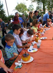 Kids get creative with pumpkin painting at the Blackwood Pumpkin Festival. The annual event returns Oct. 7.