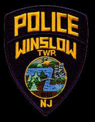 Winslow police say two men who allegedly posed as officers had a gun, crowbar in their vehilce.