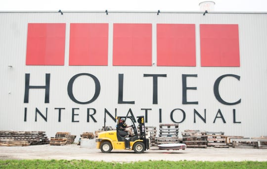 An employee operates a forklift on the campus of Holtec International in Camden on Friday, September 14, 2018.