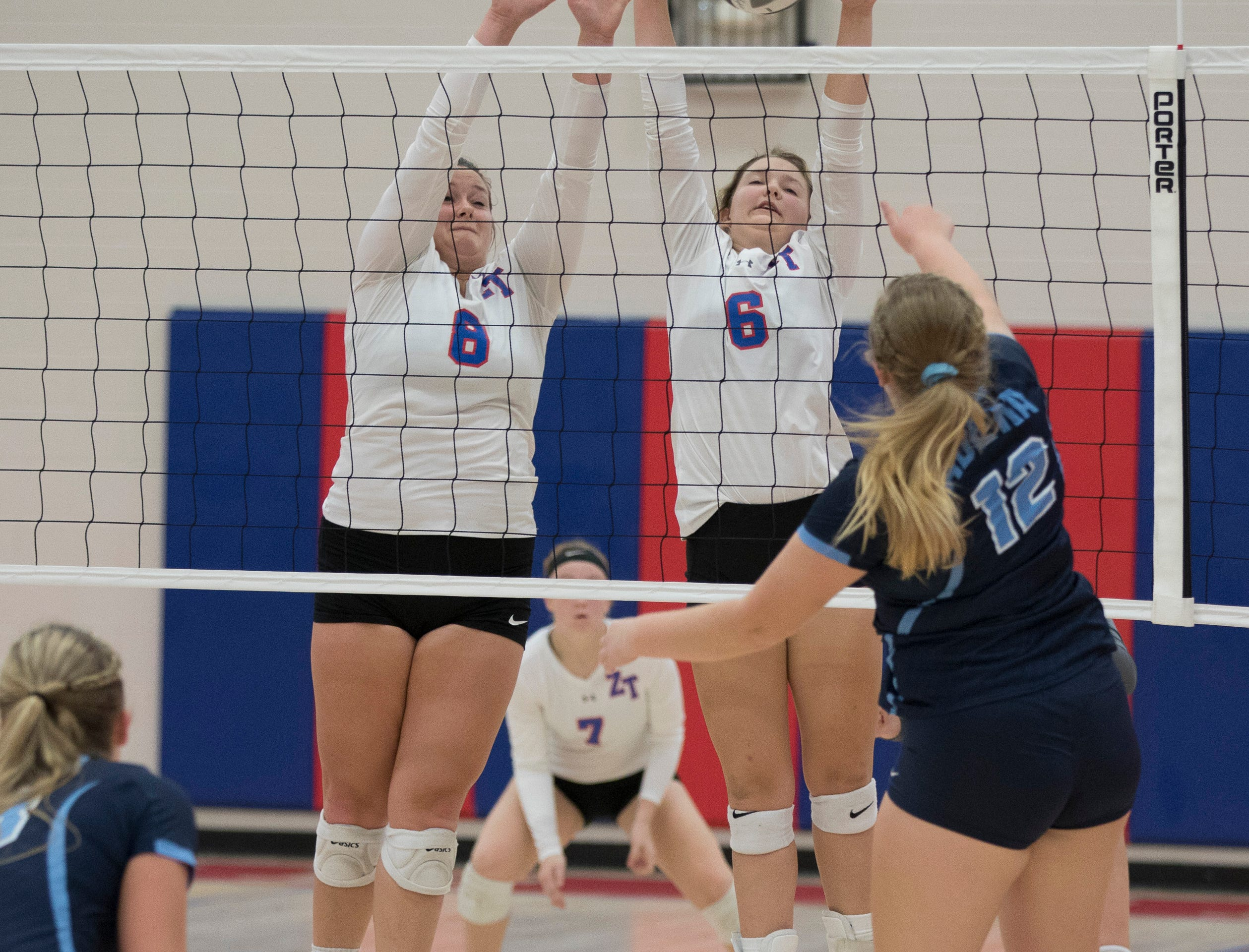 Hannah Unger and Alli Bennett block the ball returned by Adena Thursday night at Zane Trace High School. Zane Trace would go on to defeat Adena 3-0.