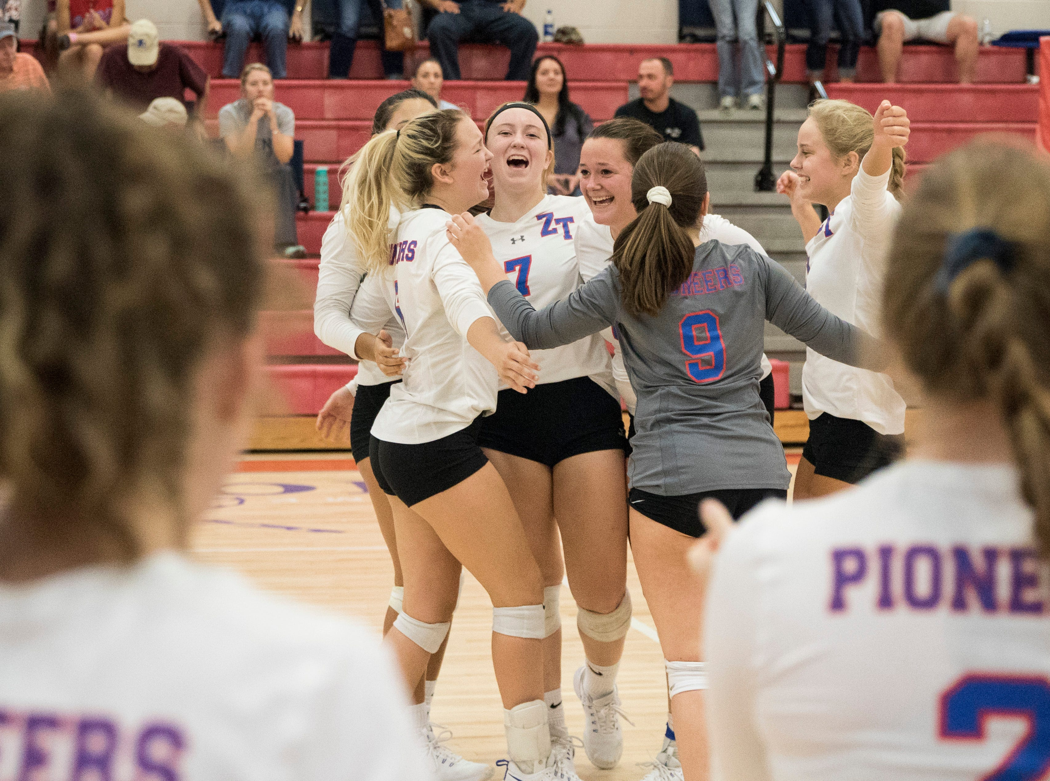 Zane Trace's girls volleyball team celebrates their 3-0 win over Adena Thursday night at Zane Trace High School. The win gives the team an overall record of 6-3 for the season so far.
