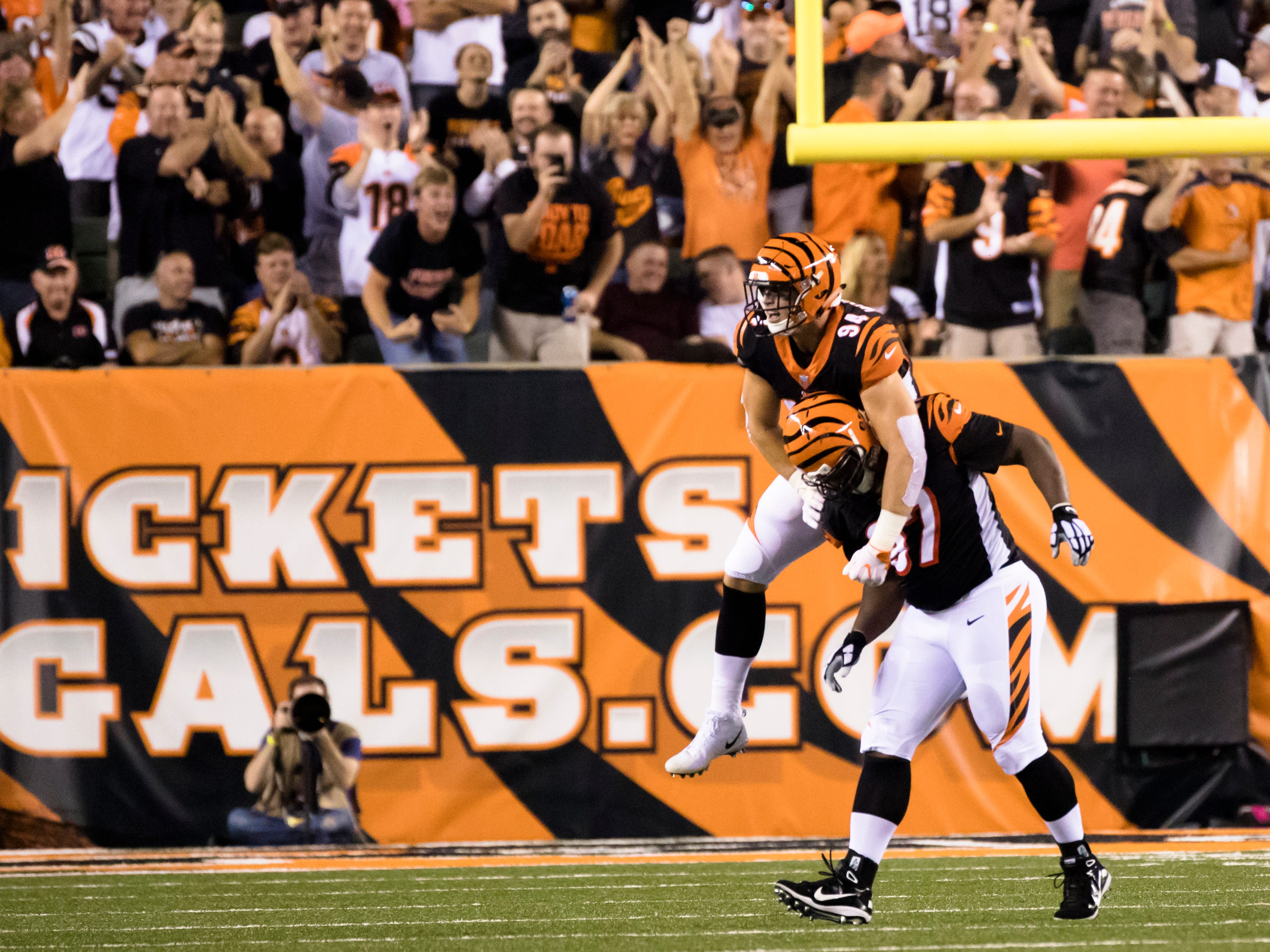 Cincinnati Bengals defensive end Sam Hubbard (94) celebrates with Cincinnati Bengals defensive tackle Geno Atkins (97) after a stop during the Week 2 NFL game between the Cincinnati Bengals and the Baltimore Ravens, Thursday, Sept. 13, 2018, at Paul Brown Stadium in Cincinnati.