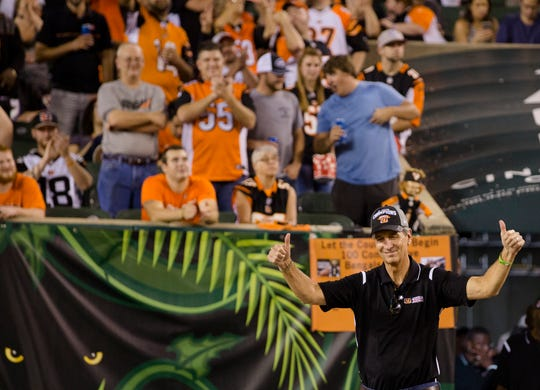 1988 Bengals team member Cris Collinsworth takes the field with the rest of the team during the Week 2 NFL game between the Cincinnati Bengals and the Baltimore Ravens, Thursday, Sept. 13, 2018, at Paul Brown Stadium in Cincinnati.