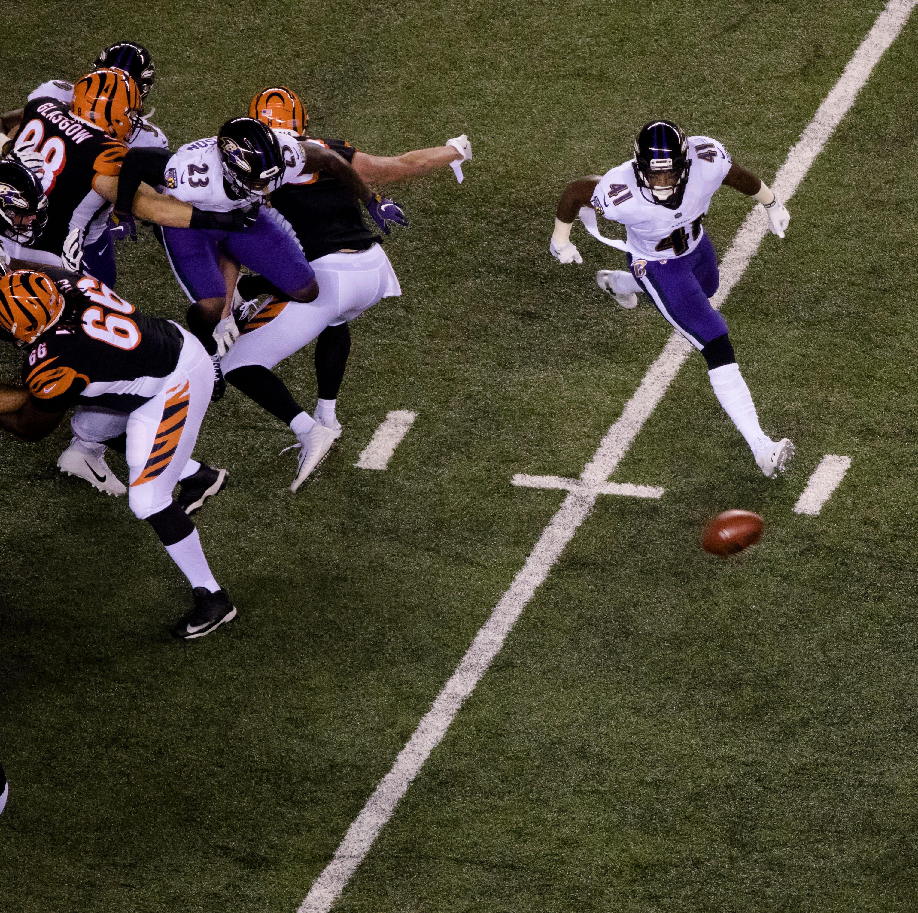 Cincinnati Bengals kicker Randy Bullock (4) hits...