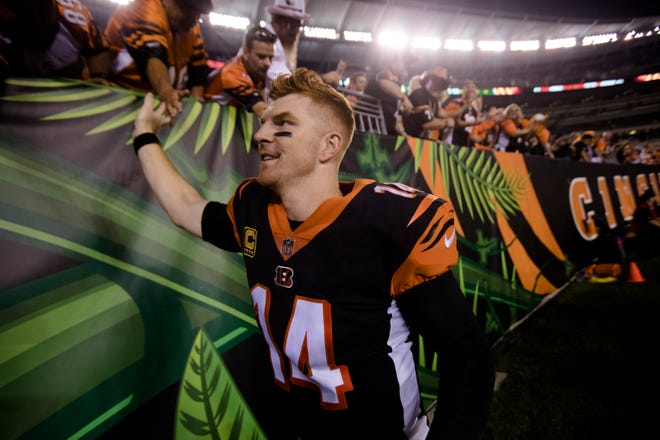 Cincinnati Bengals quarterback Andy Dalton (14) celebrates with fans after the Week 2 NFL game between the Cincinnati Bengals and the Baltimore Ravens, Thursday, Sept. 13, 2018, at Paul Brown Stadium in Cincinnati. Cincinnati Bengals defeated Baltimore Ravens 34-23.