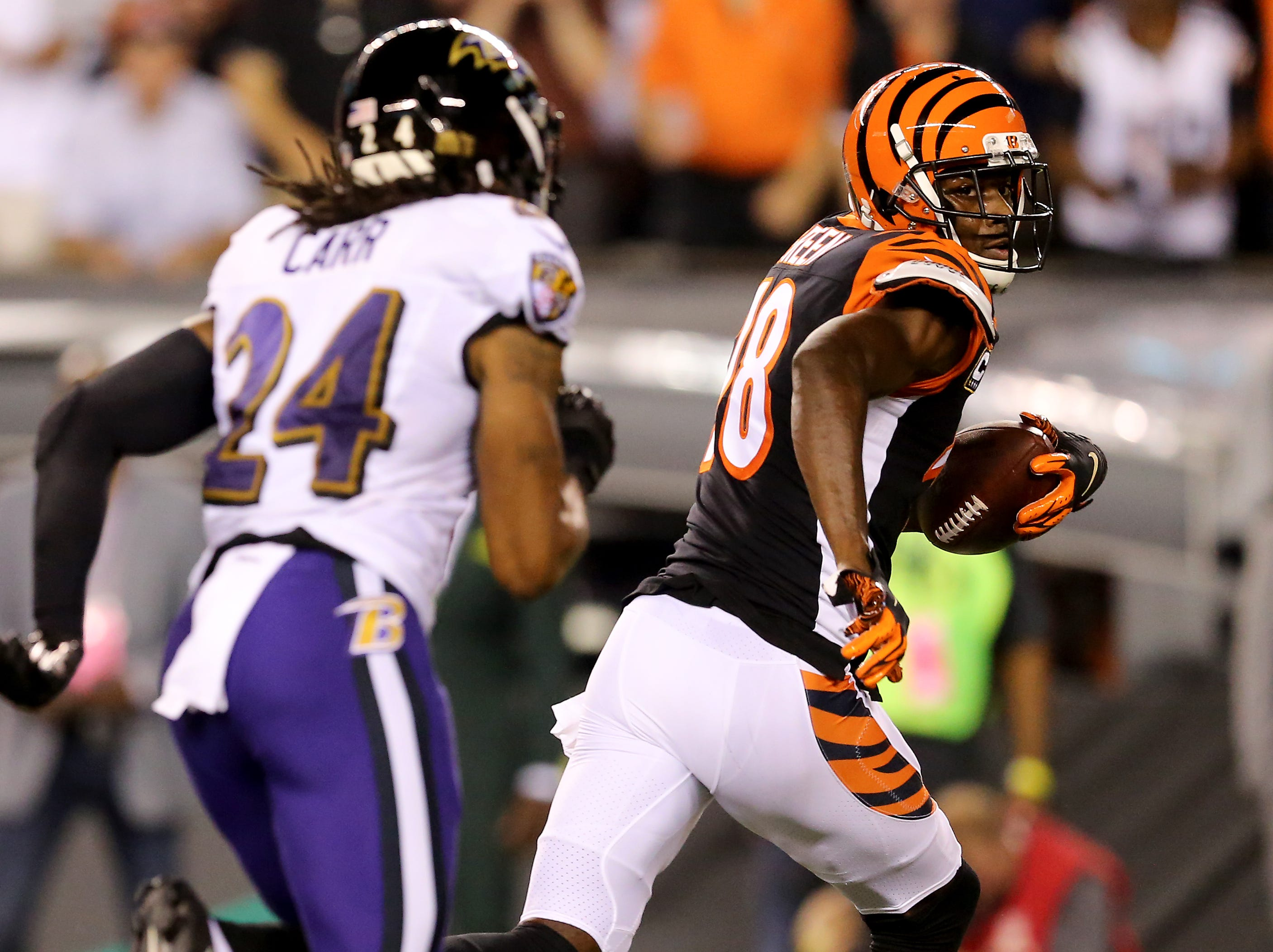 Cincinnati Bengals wide receiver A.J. Green (18) looks back as Baltimore Ravens defensive back Brandon Carr (24) on a catch and run for a touchdown in the first quarter during the Week 2 NFL football game between the Baltimore Ravens and the Cincinnati Bengals, Thursday, Sept. 13, 2018, Paul Brown Stadium in Cincinnati.