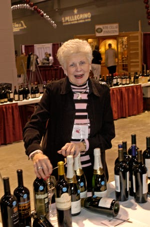 Marjorie  Valvano volunteering at the Cincinnati International Wine Festival.