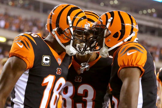 Cincinnati Bengals wide receiver A.J. Green (18) celebrates a touchdown catch with Cincinnati Bengals wide receiver Tyler Boyd (83), center, and Cincinnati Bengals wide receiver John Ross (15), right, in the first quarter during the Week 2 NFL football game between the Baltimore Ravens and the Cincinnati Bengals, Thursday, Sept. 13, 2018, Paul Brown Stadium in Cincinnati.