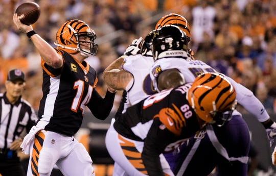 Cincinnati Bengals quarterback Andy Dalton (14) throws a pass during the Week 2 NFL game between the Cincinnati Bengals and the Baltimore Ravens, Thursday, Sept. 13, 2018, at Paul Brown Stadium in Cincinnati.