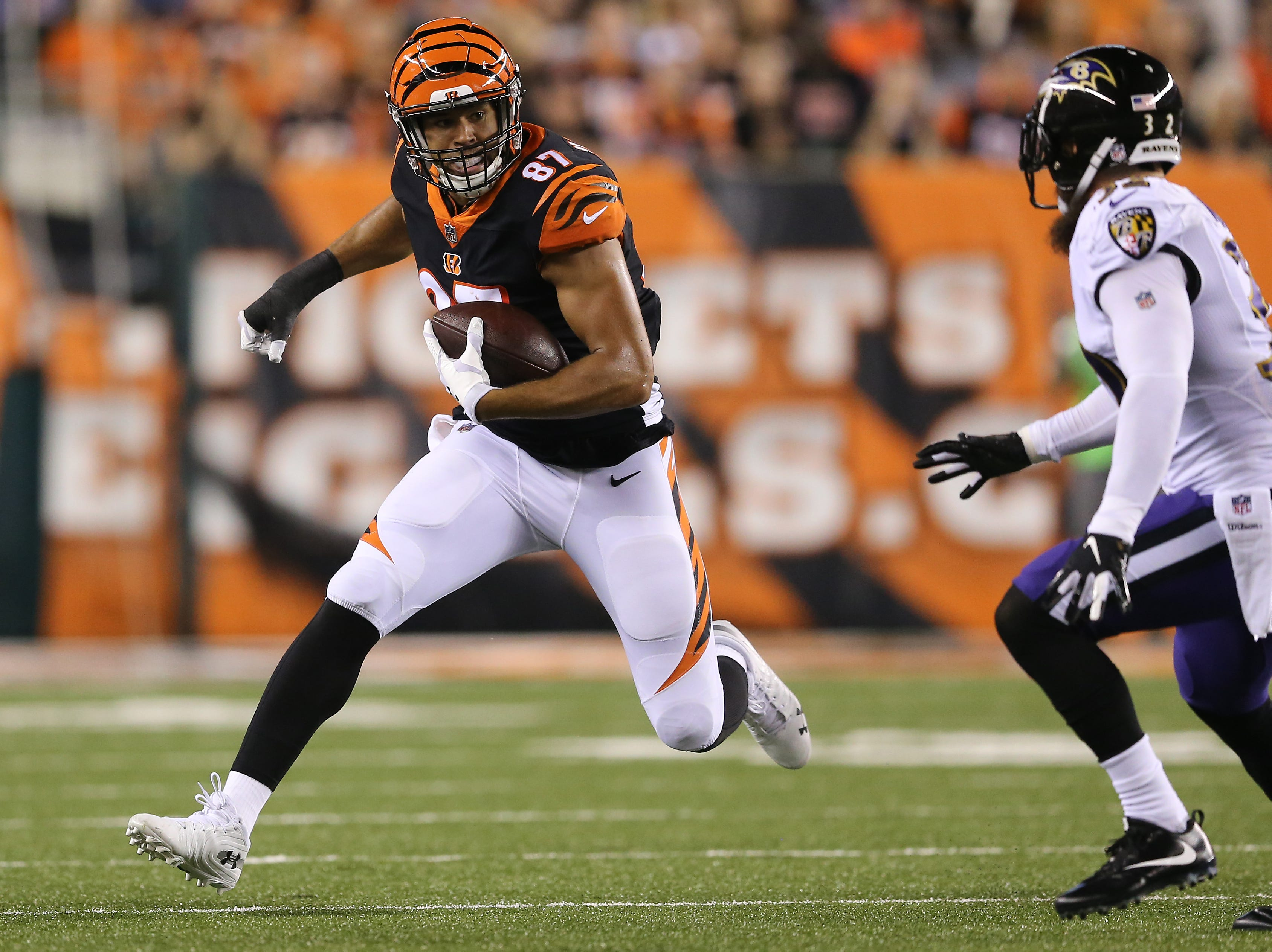 Cincinnati Bengals tight end C.J. Uzomah (87) runs downfield after a catch in the first quarter during the Week 2 NFL football game between the Baltimore Ravens and the Cincinnati Bengals, Thursday, Sept. 13, 2018, Paul Brown Stadium in Cincinnati.